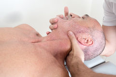 Cervical manipulation Stock Photography