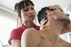 Cervical pain cured by physiotherapist stock photo