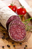 Cervine Salami. As closeup on a wooden plate royalty free stock images
