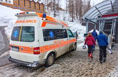 CERVINIA, ITALY - MARCH 5, 2018: Ambulance near the ski lift in royalty free stock photography