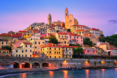 Cervo on mediterranean coast of Liguria, Italy. Dramatic sunset over medieval town Cervo on italian Riviera, Liguria, Italy Royalty Free Stock Image