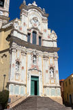 Cervo - The painted facade of st. John overlooking the sea, Province of Imperia. Cervo is a small, ancient town built on top of a hill along the Italian Riviera stock photography