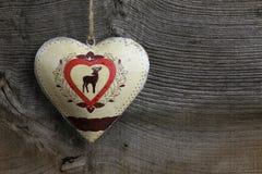 Cervos da decoração do Feliz Natal em Tin Heart Foto de Stock Royalty Free