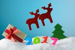 Cervos da decoração do Natal em um fundo azul Foto de Stock