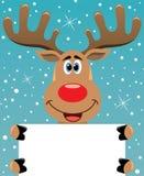 Cervos de Rudolph que prendem o papel em branco para seu texto Imagem de Stock