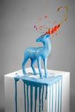 Cervos mágicos bonitos com os chifres de derretimento coloridos Imagem de Stock