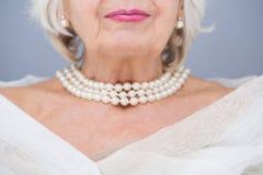 Ces perles m'adapte Image stock