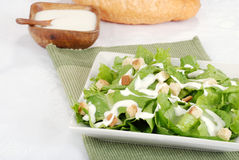 Cesar salad. With loaf of bread in background Royalty Free Stock Photo