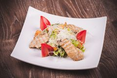 Cesar salad with chiken, tomato, croutons and cheese Royalty Free Stock Image