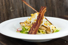 Cesar Salad. Delicious cesar salad on plate Royalty Free Stock Photos