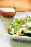 Cesar salad on green napkin Royalty Free Stock Images