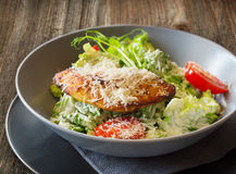 Cesar salad. Plate of cesar salad on wooden table Stock Image