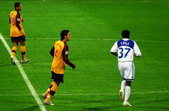 Cesc fabregas. And two more players at the beggining of the match Stock Photography