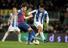 Cesc Fabregas(L) vies with (R) Markel Bergara(R) Royalty Free Stock Images