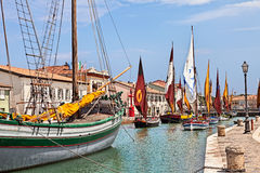 Cesenatico, Emilia Romagna, Italy: historic sailing boats. Cesenatico, Emilia Romagna, Italy: the port canal with historic fishing sailing boats of the Adriatic stock image