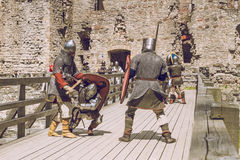 Cesis, Latvia, Medival festival in Livonian Castle. Cesis, Latvia, Medival festival in Livonian Castle, Street view, medival fight, 2015 year. It`s a travel Stock Photo