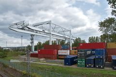 Ceska Trebova, Czech Republic - 20.4.2019: Container train terminal company METRANS. Cranes for loading containers. Railway. Junction and railway station Ceska stock image