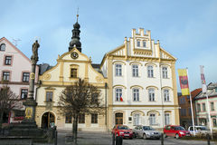 Ceska Trebova, old and new town hall. Ceska Trebova, Czech republic: the square with old and new town hall with coat of arms of the city and with plague column stock photos