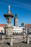 Ceske Budejovice water fountain and tower Royalty Free Stock Image