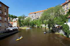 Cesky Krumlov Castle and rafting on Vltava river Stock Photo