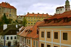 Cesky Krumlov Church Castle Day Autumn. View on the historic center true the hotel window with Church and Castle in the background Royalty Free Stock Photos