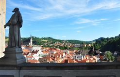 Cesky Krumlov, Czech republic - July 9, 2015: View of Cesky Krumlov with a statue of some saint man. In left royalty free stock photo