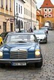 CESKY KRUMLOV, CZECH REPUBLIC - SEPTEMBER 20, 2014: Run of old retro cars on city streets.  Royalty Free Stock Photos
