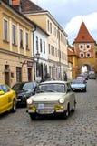 CESKY KRUMLOV, CZECH REPUBLIC - SEPTEMBER 20, 2014: Run of old retro cars on city streets.  Royalty Free Stock Photo