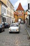 CESKY KRUMLOV, CZECH REPUBLIC - SEPTEMBER 20, 2014: Run of old retro cars on city streets.  Stock Photography