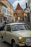 CESKY KRUMLOV, CZECH REPUBLIC - SEPTEMBER 20, 2014: Run of old retro cars on city streets.  Royalty Free Stock Images