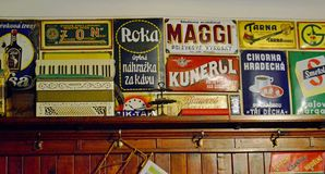 Cesky Krumlov - Retro tin signs in restaurant. Český Krumlov is a town in the South Bohemian Region of the Czech Republic. Its historic centre, centred royalty free stock photos