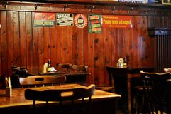 Cesky Krumlov - Retro tin signs in restaurant. Wooden panelling interior. Český Krumlov is a town in the South Bohemian Region of the Czech Republic royalty free stock image