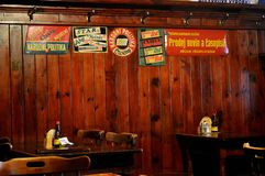Cesky Krumlov - Retro tin signs in restaurant. Wooden panelling interior. Český Krumlov is a town in the South Bohemian Region of the Czech Republic stock photos