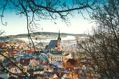 Cesky Krumlov in winter, Czech Republic, Europe. Panoramic view of Cesky Krumlov in winter, Czech Republic. View of the snow-covered red roofs. Travel and Stock Images