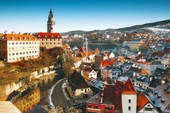 Cesky Krumlov in winter, Czech Republic, Europe. Panoramic view of Cesky Krumlov in winter, Czech Republic. View of the snow-covered red roofs. Travel and Stock Photos