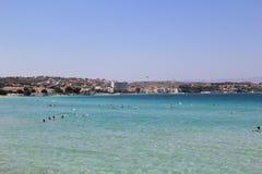 Cesme Aegean Sea and Beach. People are swimming wonderful Cesme Aegean Sea Stock Images