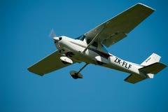 Cessna 152 in flight. A Cessna airplane in flight against a clear blue sky