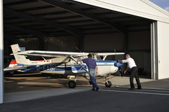 Cessna 152  Pushed Back into the Hanger. Cessna 152 pushed back into the hanger at the Royalty Free Stock Photos