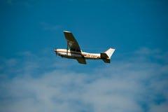Cessna 172RG Cutlass RG II in flight. A Cessna 172RG Cutlass RG II airplane in flight against a blue sky Royalty Free Stock Photos