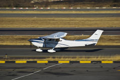 Cessna 182 Skylane - Touch 'n Go. This frame taken during a Touch 'n Go landing … This light aircraft [Cessna 182 Skylane] is getting airborne, shortly after Stock Photo