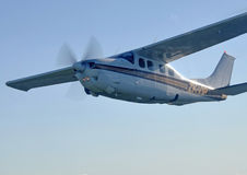 Cessna 210. Light aircraft against blue sky Royalty Free Stock Photography