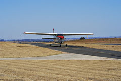 Cessna 210. Ready, Steady, Fly … This light aircraft [Cessna 210] is taxiing down the runway to get airborne Stock Photos