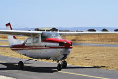 Cessna 210 - Closer 02. Ready, Steady, Fly … This light aircraft [an Cessna 210] is taxiing down the runway to get airborne Royalty Free Stock Photos