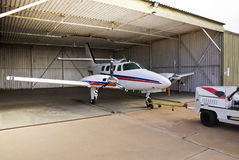 Cessna 303 Crusader Parked in Hangar Royalty Free Stock Images