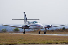 Cessna 303 Crusader Takeoff 01. The T303 is an all-metal low-wing six-seat piston-powered aircraft twin-engined aircraft with a tricycle undercarriage Stock Photo