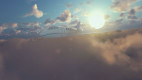 Cessna airplane flying above clouds at sunrise stock video
