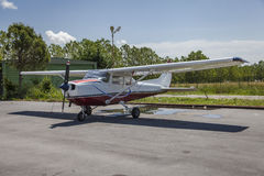 Cessna airplane. Cessna: a small airplane stands on the airfield at , with clouds in the background Stock Photos
