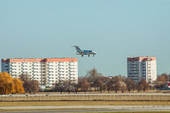 Cessna 510 Citation Mustang. Kiev Region, Ukraine - November 13, 2011: Cessna 510 Citation Mustang is landing in the airport with some buildings on the Stock Image