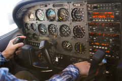 Cessna 172 Cockpit Airplane Flight Instrument Panel with Pilot Royalty Free Stock Photos