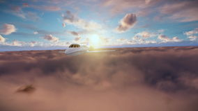 Cessna flying above clouds at sunrise stock footage